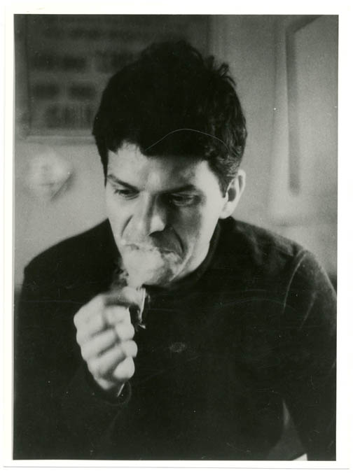 A b/w photograph by Harold Chapman of Gregory Corso in room 41 at the Beat Hotel, c. late 1957/early 1958.