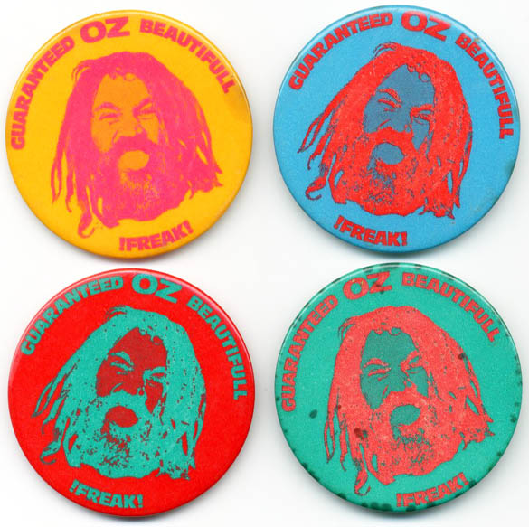 A group of Oz 'Beautiful Freak!' badges in four different colourways: blue and red; red and green; green and red (negative photo images); and orange and red (positive photo image). OZ BADGES.