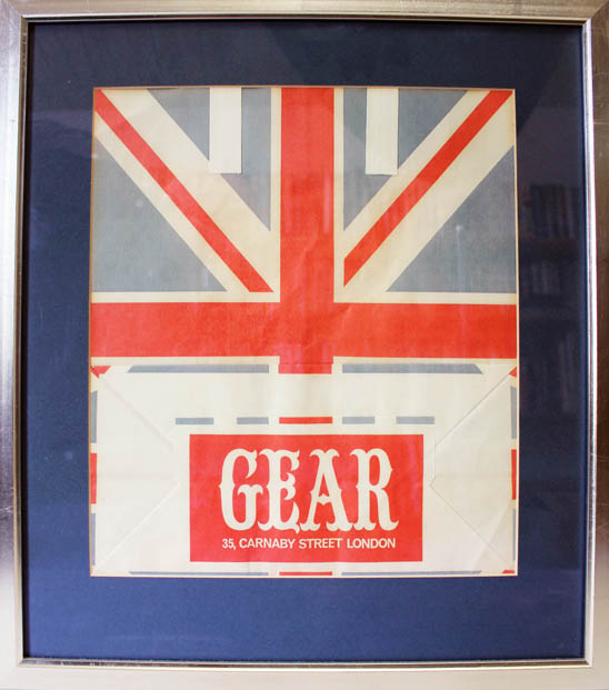 An original paper carrier bag from Gear, Tom Salter's Carnaby Street boutique, featuring a Union flag design, c. 1965. GEAR.