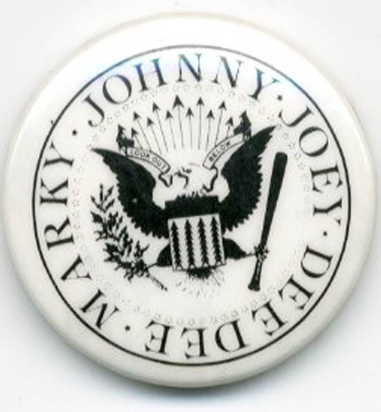 "Original badge reproducing Arturo Vega's logo of a redesigned presidential seal, intended to represent The Ramones ""as the ultimate all-American band"". No date (c. 1978). The RAMONES."
