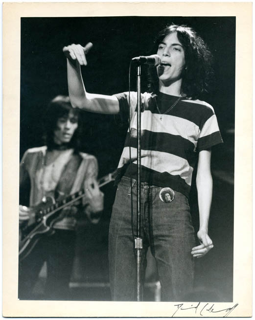 An original 9x7 b/w photograph by David Arnoff of Patti Smith onstage (probably at The Roxy, Los Angeles, 15th November, 1976). Patti SMITH.
