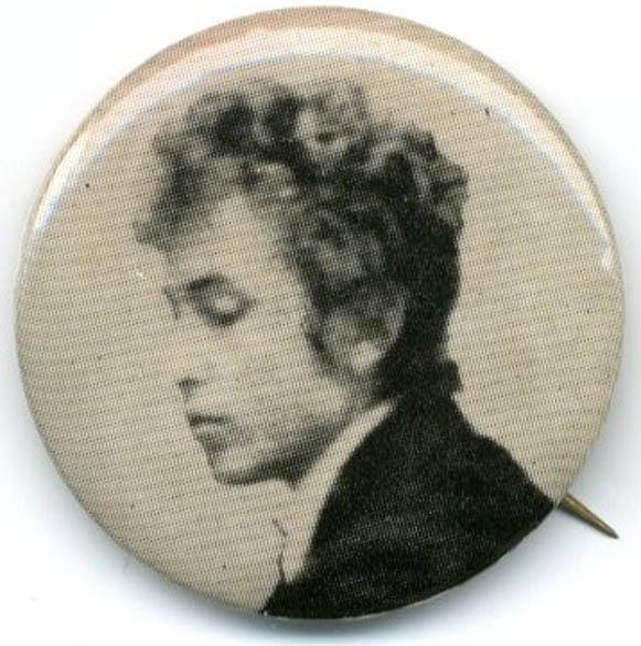 Vintage pinback button reproducing a b/w head and shoulders photograph of Bob Dylan, c. 1965. Bob DYLAN.