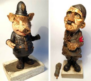 Pig Policeman and Adolf Hitler. Two models created by the sculptor, Edwin Belchamber, as featured...