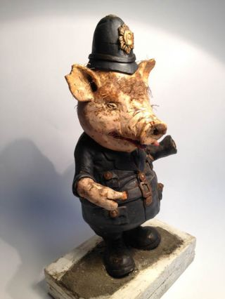 Pig Policeman and Adolf Hitler. Two models created by the sculptor, Edwin Belchamber, as featured in Oz magazine, May and July 1971.