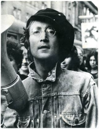An original photograph by Ron Reid of John Lennon on a demonstration march in central London, August 11th, 1971, in support of Oz magazine (and in protest against the use of British troops in Northern Ireland). John LENNON.