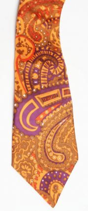 An original orange, purple and red paisley print men's tie, c. 1967. I WAS LORD KITCHENER'S VALET.