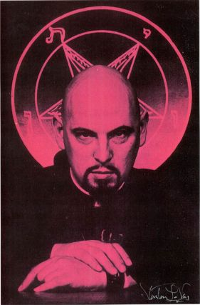 Small poster depicting Anton LaVey in characteristic Ming the Merciless pose in front of his...