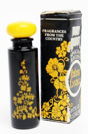 A miniature bottle of Mary Quant 'Wistaria' perfume, with original box. Mary QUANT.