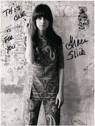 Herb Greene's famous b/w photograph of Grace Slick in her paisley psychedelic trouser suit flipping the bird in front of the hieroglyphics-covered wall at The Matrix Club, San Francisco, December 1966. Grace SLICK.